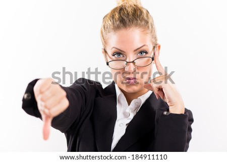 Portrait of attractive businesswoman showing thumbs down. Looking at camera.