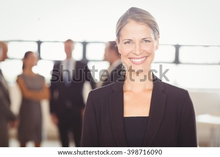 Portrait of attractive businesswoman smiling at camera - stock photo