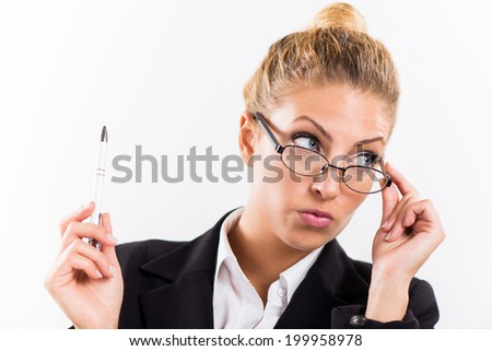 Portrait of attractive businesswoman with glasses. She is holding pen.