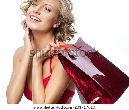 portrait of attractive  caucasian smiling woman blond isolated on white studio shot  toothy smile  hair  looking at camera shopping bags sale - stock photo