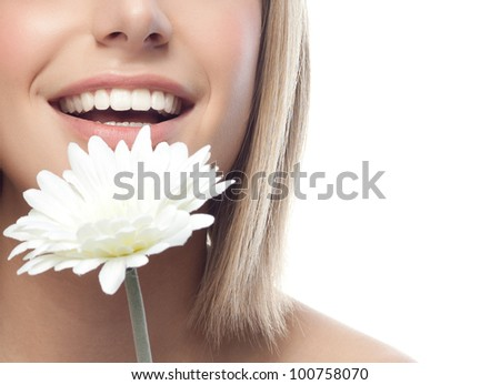 portrait of attractive  caucasian smiling woman blond isolated on white studio shot with flower - stock photo