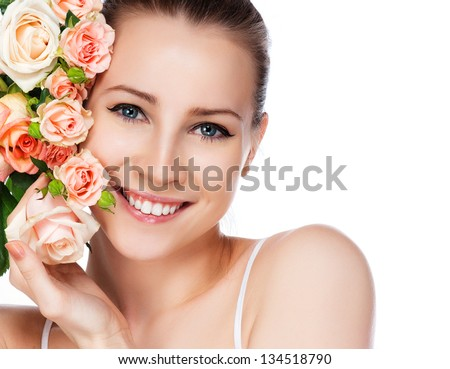 portrait of attractive caucasian smiling woman blond with roses isolated on white studio shot - stock photo