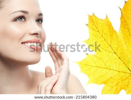 portrait of attractive  caucasian smiling woman brunette isolated on white studio shot autumn leave - stock photo