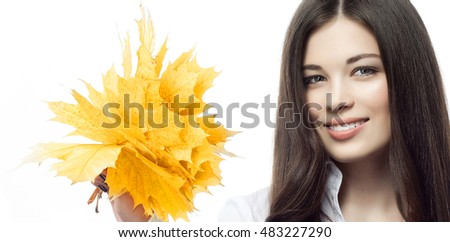 portrait of attractive  caucasian smiling woman brunette isolated on white studio shot hand holding yellow marple autumn leaves