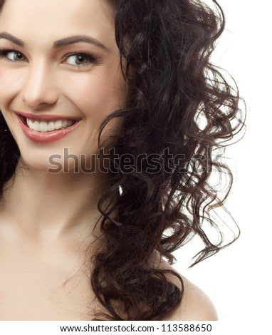 portrait of attractive  caucasian smiling woman brunette isolated on white studio shot head and shoulders face skin hand hair looking at camera
