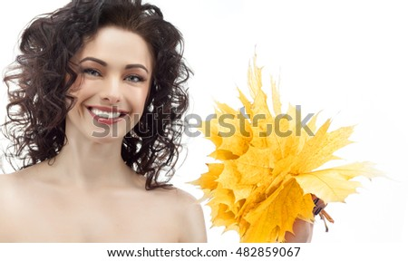 portrait of attractive  caucasian smiling woman brunette isolated on white studio shot head and shoulders face shin hair hand holding yellow marple autumn leaves