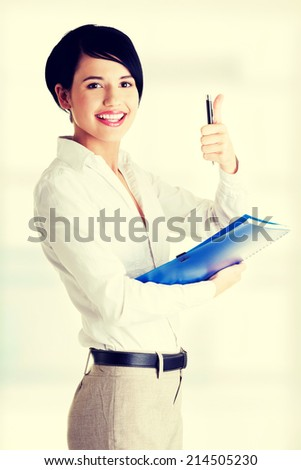 Portrait of attractive  caucasian smiling woman gesturing thumb up - stock photo