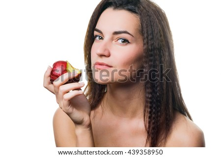 portrait of attractive caucasian smiling woman isolated on white background eating red apple - stock photo