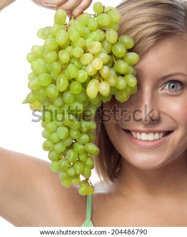 portrait of attractive  caucasian smiling woman isolated on white studio shot eating grapes - stock photo
