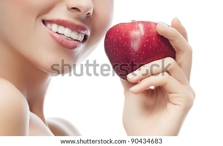 portrait of attractive  caucasian smiling woman isolated on white studio shot eating red apple - stock photo