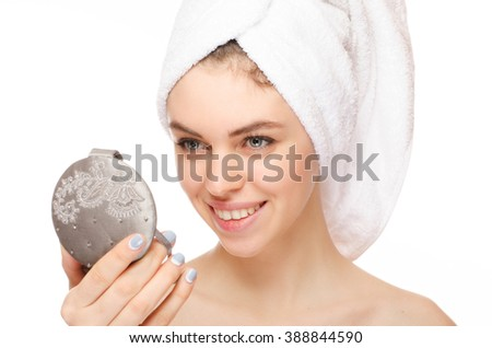 portrait of attractive  caucasian smiling woman isolated on white studio shot looking at the mirror - stock photo