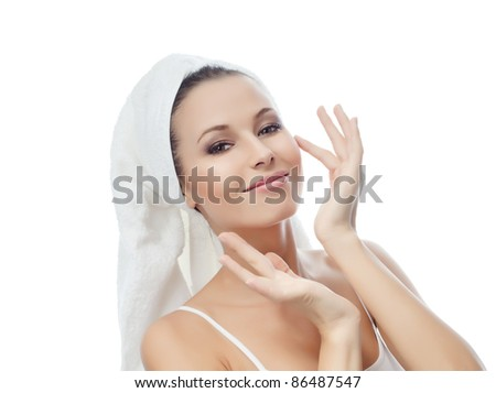 portrait of attractive  caucasian smiling woman isolated on white studio shot towel on head looking at camera - stock photo