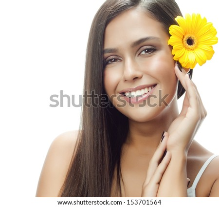 portrait of attractive  caucasian smiling woman isolated on white studio shot with flower - stock photo