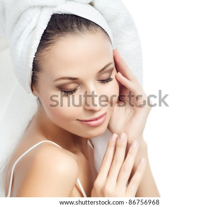 portrait of attractive  caucasian smiling woman isolated on white studio shot with towel on head eyes closed