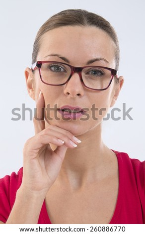 portrait of attractive caucasian smiling woman wearing glasses  isolated on white studio shot looking at camera - stock photo