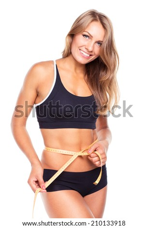 Portrait of attractive caucasian smiling woman with measuring tape isolated on white background - stock photo
