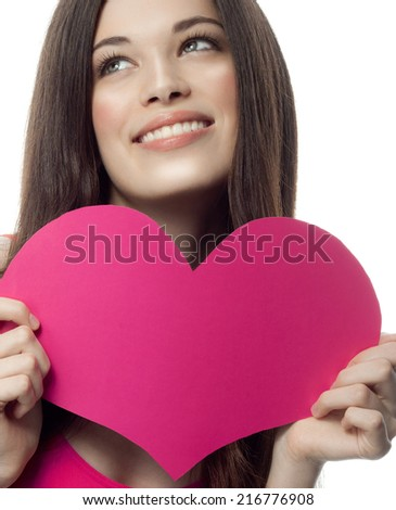 portrait of attractive  caucasian smiling young woman blond isolated on white studio shot with heart  - stock photo