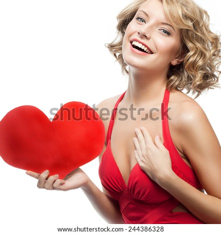 portrait of attractive  caucasian smiling young woman blond isolated on white studio shot with heart red dress - stock photo