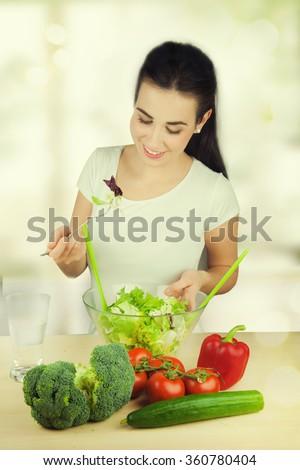 portrait of attractive caucasian woman eating salat - stock photo