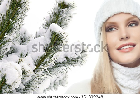 portrait of attractive  caucasian woman  with long blond hair in warm clothing isolated on white studio shot christmas tree snow covered new year