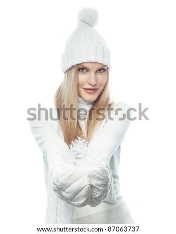 portrait of attractive  caucasian woman  with long blond hair in warm clothing  isolated on white studio shot looking at camera - stock photo