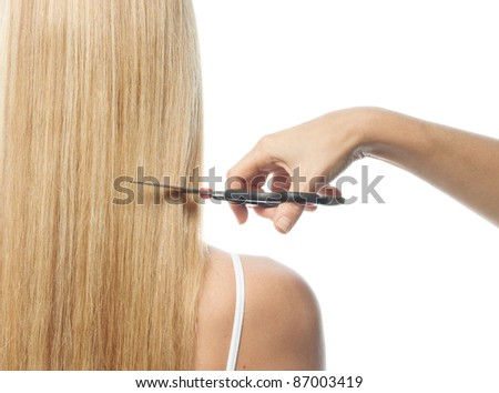portrait of attractive  caucasian woman  with long blond hair isolated on white studio shot back - stock photo