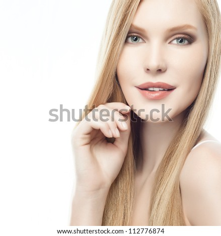 portrait of attractive  caucasian woman  with long blond hair isolated on white studio shot looking at camera
