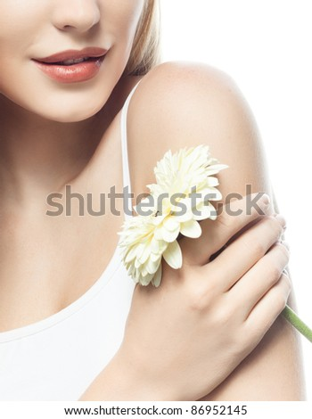 portrait of attractive  caucasian woman  with long blond hair isolated on white studio shot  with flower closeup - stock photo