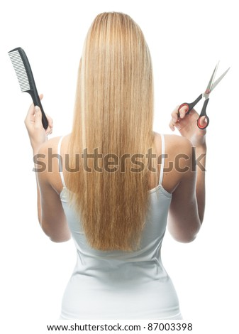 portrait of attractive  caucasian woman  with long blond hair isolated on white studio shot with comb and scissors back - stock photo