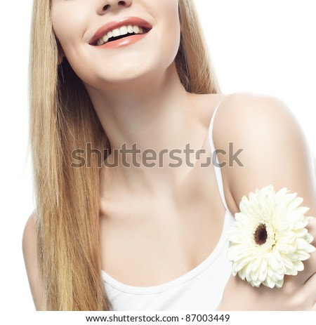 portrait of attractive  caucasian woman  with long blond hair isolated on white studio shot with flower smiling - stock photo
