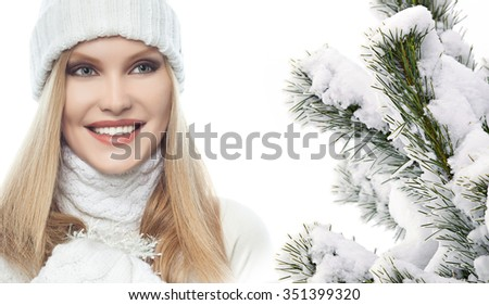 portrait of attractive  caucasian woman  with long blond hair th warm clothing isolated on white studio shot  christmas tree snow covered new year