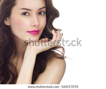 portrait of attractive  caucasian  young woman brunette, isolated on white , studio shot, face, looking at camera; hand, lips; makeup; long hair; head and shoulders - stock photo