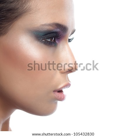 portrait of attractive  caucasian young  woman brunette isolated on white studio shot face closeup skin makeup eyes profile side view - stock photo