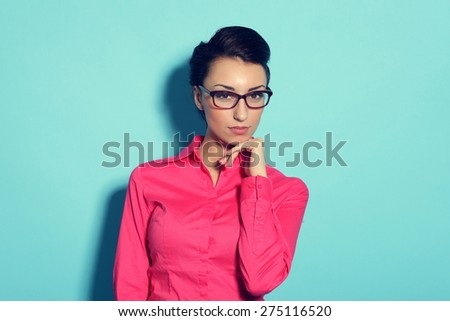 Portrait of attractive cheerful young woman in glasses - stock photo