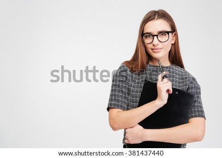 Portrait of attractive confident businesswoman in glasses with clipboard and pen over white background - stock photo