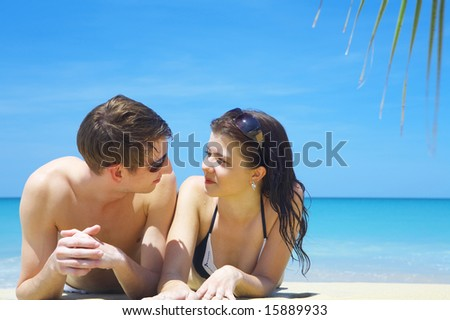 portrait of attractive couple having date on the beach - stock photo