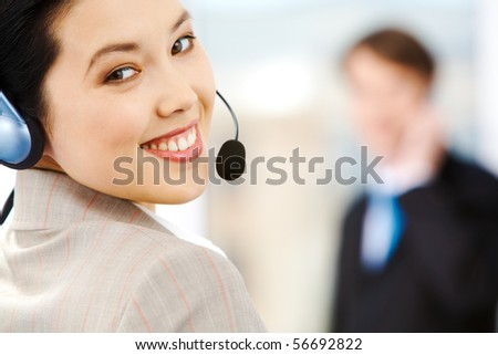 Portrait of attractive customer support service representative wearing headset