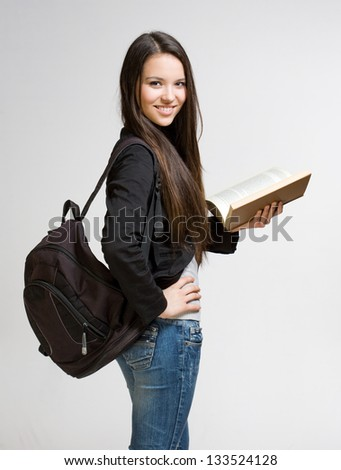 Portrait of attractive cute young student girl. - stock photo
