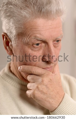 Portrait of attractive elderly man at home