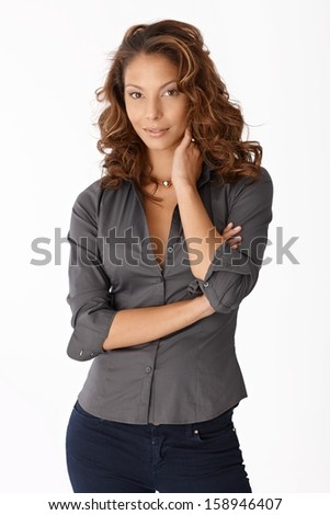 Portrait of attractive ethnic woman standing arms crossed, looking at camera.