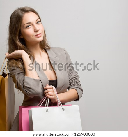 Portrait of attractive fashionable young brunette shopper. - stock photo