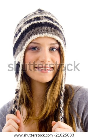 portrait of attractive female wearing woolen cap on an isolated background - stock photo