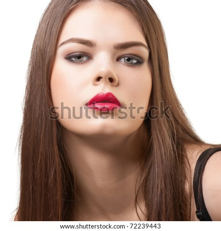 Portrait of attractive female with bright make-up looking at camera, against white background - stock photo