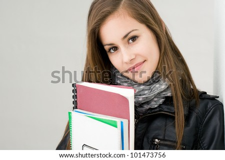 Portrait of attractive fresh young brunette student girl.