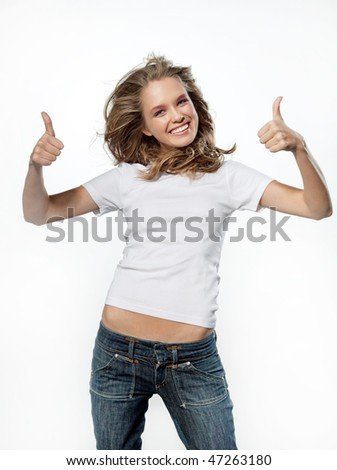 portrait of attractive girl showing thumbs up sign over on whitebackground - stock photo