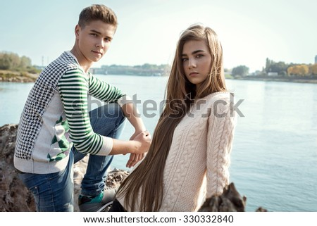 Portrait of attractive girl with long hair and handsome boy posing each other - stock photo
