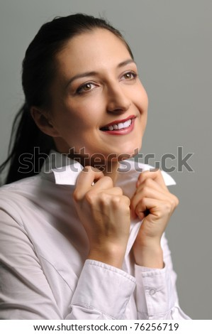 Portrait of attractive happy brunette in white shirt