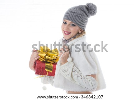 portrait of attractive happy girl in winter hat with gifts