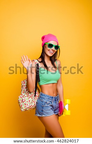 Portrait of attractive happy girl with glasses gesturing hello