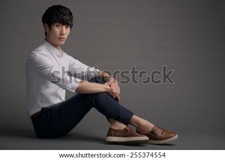 Portrait of attractive Korean young man - stock photo